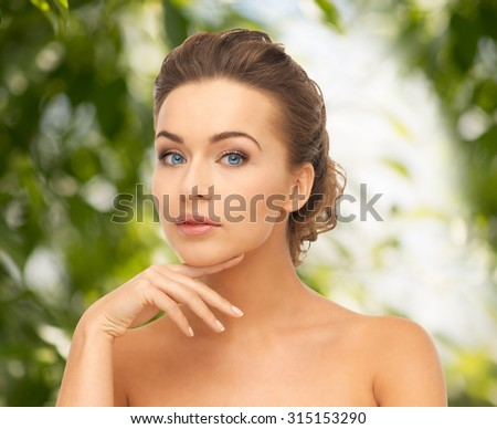 beauty, spa, eco cosmetology concept - beautiful woman with long hair