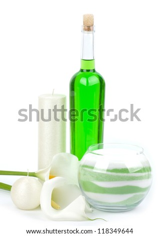Beauty spa oils and salt with white callas on white background