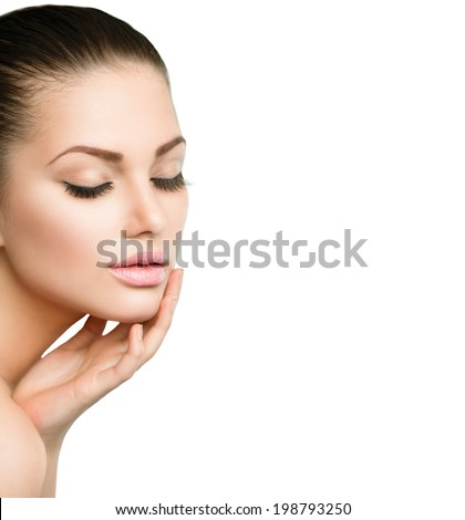 Beauty Spa Woman Portrait. Beautiful Girl Touching her Face. Isolated on white background. Close eyes. Soft skin. Skincare concept - stock photo