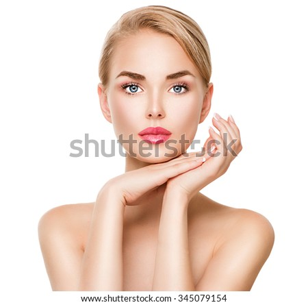 Beauty spa young woman portrait isolated on white. Beautiful model girl with beauty makeup touching her perfect fresh face. Attractive Blonde lady with blue eyes. Youth and Skin Care Concept - stock photo