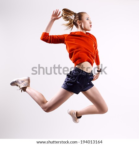 stock photo beauty sport girl jumping 194013164 woman levitating stock images, royalty free images & vectors  at crackthecode.co