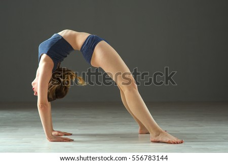beauty sport woman training on gray background