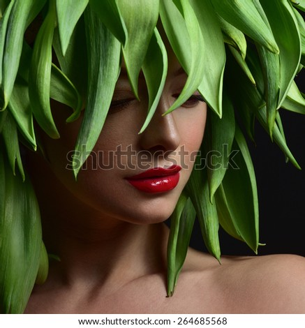 Beauty Spring or Woman with Fresh green leaves hair. Summer Nature Girl portrait.