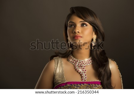 Beauty studio shot of Beautiful Indian women with jewelry - stock photo
