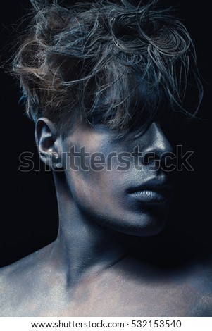 Beauty style portrait of guy isolated at dark background. Art blue and grey Makeup. Hairstyle and skincare concept.