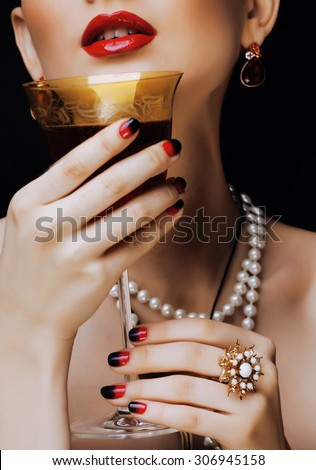 beauty stylish redhead woman with hairstyle and manicure wearing jewelry, glass of vine - stock photo