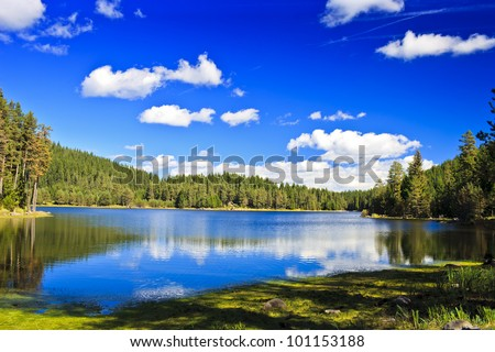 beauty sunny day in mountain lake - stock photo