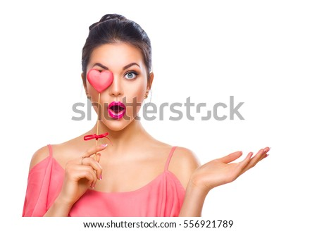 Beauty Surprised Young Fashion Model Girl With Valentine Heart Shaped  Cookie In Hand. Love.
