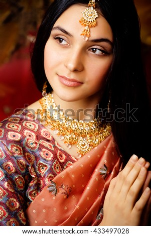 beauty sweet real indian girl in sari smiling on black background