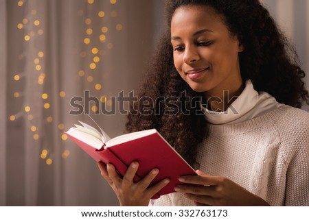 Beauty teen girl holding red covered book