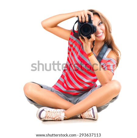 Beauty Teenage Girl photographer sitting and Smiling. Beautiful Teen Girl with professional photo camera (unrecognizable). Isolated on a White Background. Teenager