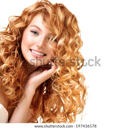 Beauty teenage model girl portrait isolated on white background. Red curly hair. Healthy wavy hair. Hairstyle. Beautiful smiling young woman portrait. Beautiful face, natural make up. Long permed hair - stock photo