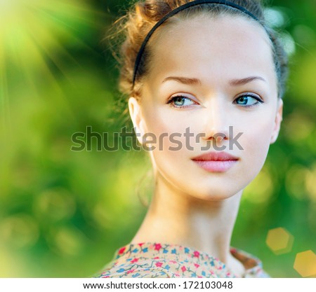 Beauty Teenage Model Spring Girl over Nature Green Background. Beauty Girl outdoors. Clean skin. Blue eyes. Beautiful face - stock photo