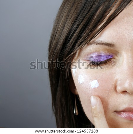 Beauty treatment on a woman face - stock photo