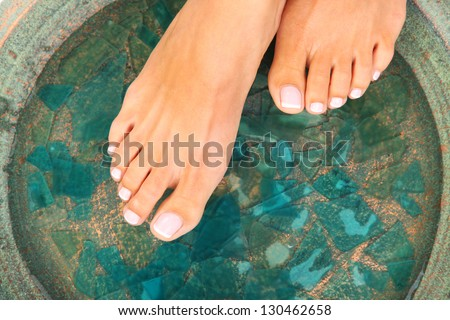 Beauty treatment photo of nice pedicured feet - stock photo