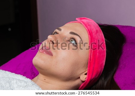 Beauty treatments in the beauty salon. Beautician revitalizing facial. Facial massage. Beauty, facial, beautician. - stock photo
