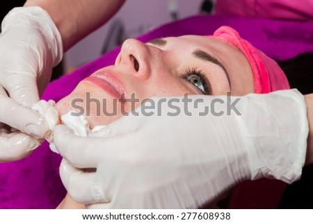 Beauty treatments in the beauty salon. Beautician revitalizing facial. Facial massage. Beauty, facial, beautician. - stock photo