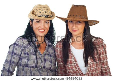 Beauty two women friends wearing cowboy's hats and squares shirts isolated on white background