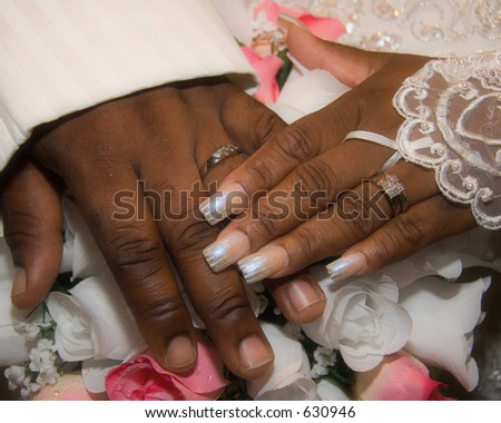 Beauty upclose as this bride's and groom show their hands adjoined with rings