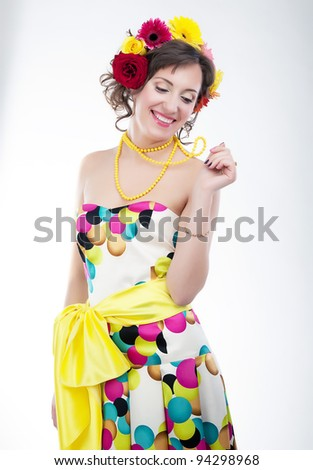 Beauty - vernal happy young woman in multicolor bright dress. Series of photos