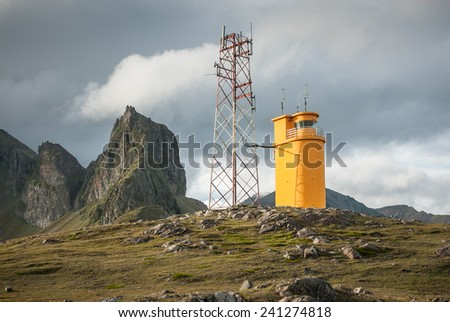 Beauty view on Hvalnes cliffs. South east part of Iceland. Orange lighthouse.  - stock photo