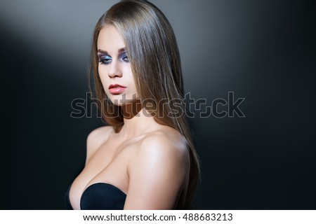 Beauty. Visage model posing with deep neckline