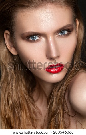Beauty Vogue Style Fashion Model Girl with Red lips and Wet Skin. Trendy Make-up. Blue Eyes. Desire - stock photo