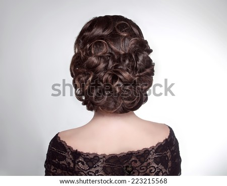 Beauty wedding hairstyle. Bride. Brunette girl with curly hair styling - stock photo