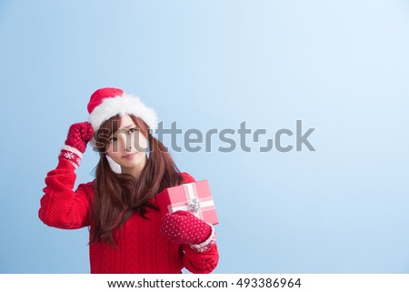 beauty woamn take gift and look smewhere in christmas isolated on blue background, asian