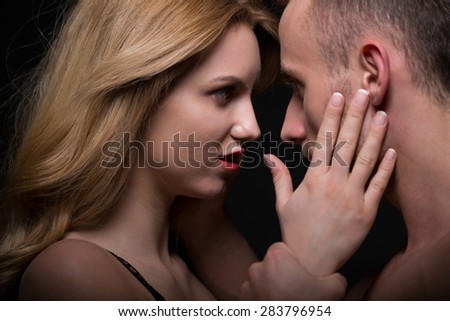 Beauty woman and handsome boyfriend looking in each other eyes - stock photo