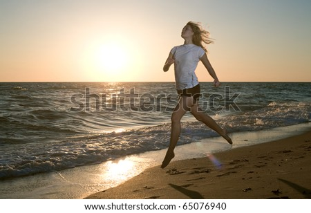beauty woman at sea in sunset