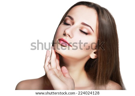 Beauty Woman. Beautiful Young Female touching Her Skin. Portrait isolated on White Background. Healthcare. Perfect Skin. Beauty Face - stock photo