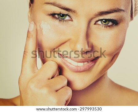 Beauty Woman. Beautiful Young Female touching Her Skin. Skincare concept. Beauty Face.Perfect Skin. Healthcare concept.Beauty concept. Instagram filter. Vintage filter applied. - stock photo
