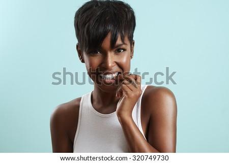 beauty woman bites her hails - stock photo