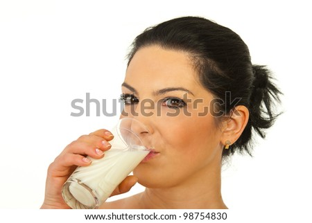 Beauty woman drinking milk isolated on white background - stock photo