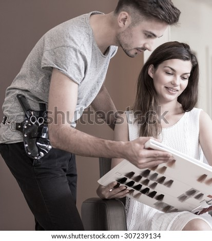Beauty woman dyeing hair in hairdressing salon - stock photo