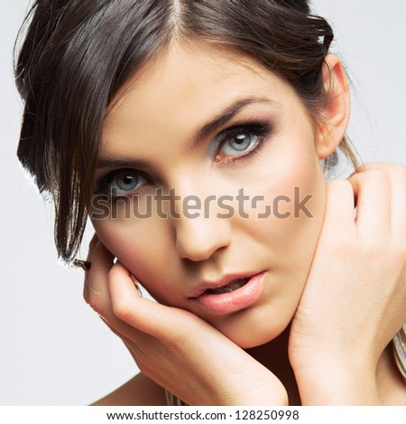 Beauty woman face close up. Female model studio posing. - stock photo