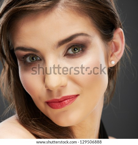 Beauty woman face close up portrait. Female young model. Studio isolated . Hairstyle long hair.