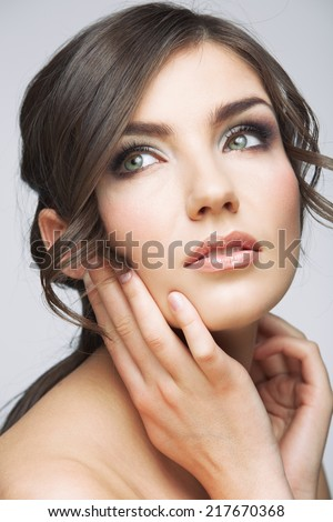 Beauty woman face close up portrait. Girl with long hair looking up side. Female model studio portrait. - stock photo