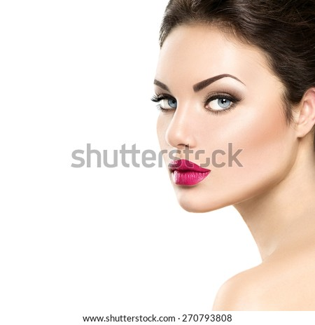 Beauty woman face closeup isolated on white background. Beautiful model girl makeup. Gorgeous lady with blue eyes and brown hair. Perfect skin. Professional make up. Red lips - stock photo