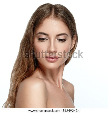 Beauty Woman face Portrait Beautiful Spa model Girl with Perfect Fresh Clean Skin. Blonde Brunette female looking camera smiling nude makeup Youth and Skin Care Concept. Isolated on a white background