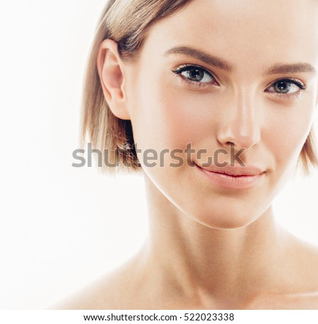 Beauty Woman face Portrait. Beautiful Spa model Girl with Perfect Fresh Clean Skin. Blonde female looking camera smiling. Shine nude makeup Youth and Skin Care Concept. Isolated on a white background