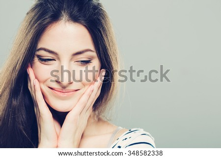 Beauty Woman face Portrait. Beautiful Spa model Girl with Perfect Fresh Clean Skin. Brunette female looking at camera and smiling. Youth and Skin Care Concept. - stock photo