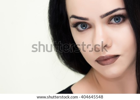 Beauty Woman face Portrait. Beautiful Spa model Girl with Perfect Fresh Clean Skin. brunette female looking at camera and smiling.