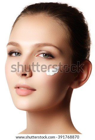 Beauty Woman face portrait. Beautiful spa model girl with perfect fresh clean skin. Female looking at camera and smiling. Youth and skin care concept. Over white background