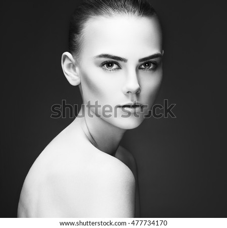 Beauty Woman face Portrait. Beautiful Spa model Girl with Perfect Fresh Clean Skin. Youth and Skin Care Concept. Isolated on a gray background
