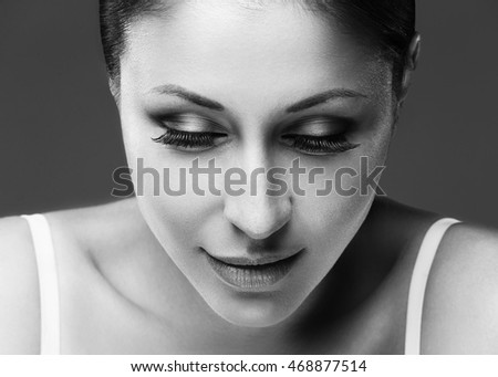 Beauty Woman face Portrait close up. Spa model Girl with Perfect Fresh Clean Skin. Big beautiful eyelashes. Isolated on a gray background