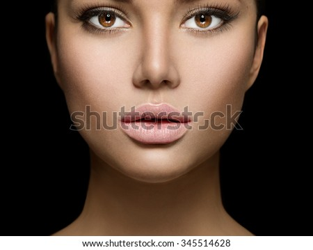 Beauty woman face portrait closeup isolated on black background. Beautiful model girl makeup. Gorgeous lady with brown eyes, perfect skin - stock photo