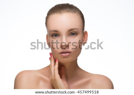 Beauty Woman face Portrait Girl with Perfect Fresh Clean Skin female looking at camera smiling.Youth and Skin Care Concept.Cheerful girl is touching her cheeks pleasure.Isolated on white background - stock photo