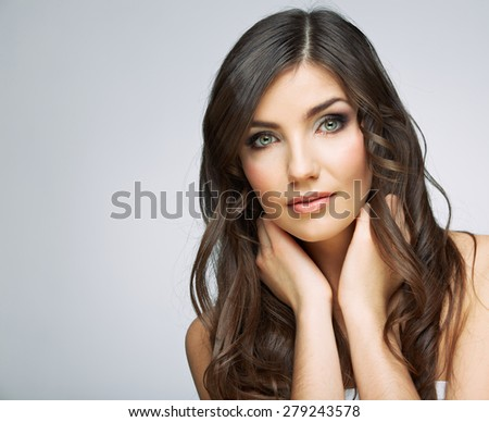 Beauty woman face portrait. Isolated on gray background. Female model studio posing. - stock photo
